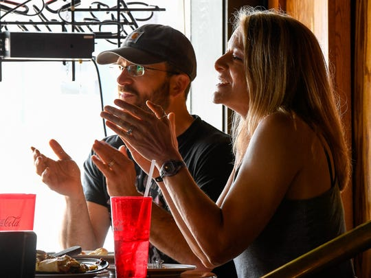 "Cory Roppel and Stacia Wolf show their appreciation following one of musician Spencer Bloodworth's tunes during a ""Handy Lunch Break"" at Rockhouse at Wolf's Wednesday, June 13, 2018."
