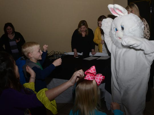 Children dance with the Easter Bunny at the YWCA's Breakfast with the Bunny event held at The Gem in downtown Alexandria on Saturday