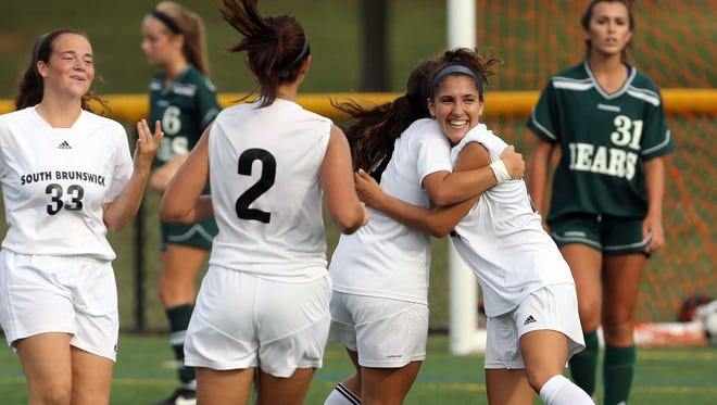 The East Brunswick High School varsity girls soccer take on South Brunswick on Tuesday September 20, 2016 at South Brunswick High School.  South Brunswick's # 23 (center) Adrianna Mouzakis celerates with team mates after scoring a 1st half goal.