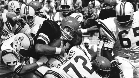 AUGUST 11, 1969: Bengals' Greg Broughton Squashed By Patriots. Boston's Larry Eishenhauer key man in tackle after 3-yard Cincinnati gain in third quarter. The Enquirer/Ran Cochran