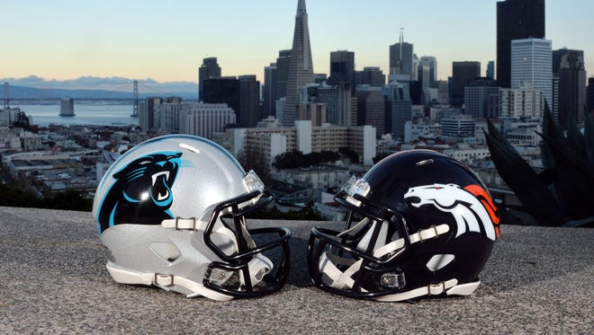 Carolina Panthers and Denver Broncos helmets with the San Francisco skyline and Bay Bridge as a backdrop prior to Super Bowl 50 between the Carolina Panthers and the Denver Broncos.