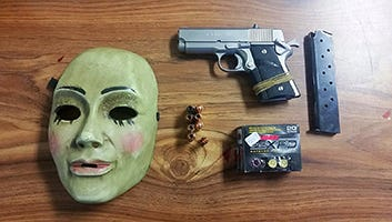 During the search of a vehicle, Tulare County sheriff's detectives discovered a loaded .45 caliber handgun, ammunition and a Halloween Mask.