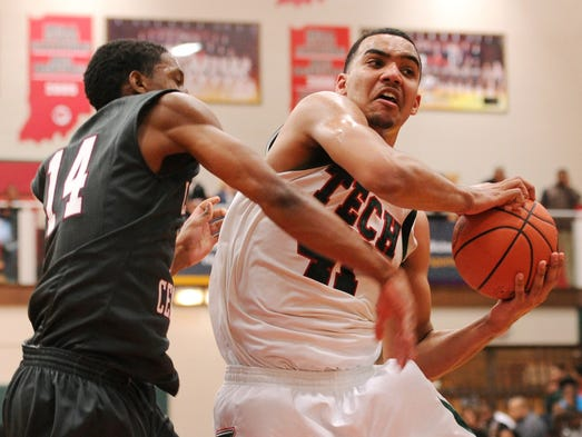 Arsenal Tech forward Trey Lyles pulls down a rebound in front of Lawrence Central guard Mekhi Biffle during the Class 4A Sectional #10 at Lawrence North, Friday, March 7, 2014, in Indianapolis. Tech won the game 77-47.