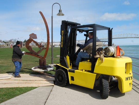 H.L. Green directs forklift driver Ken Thompson around