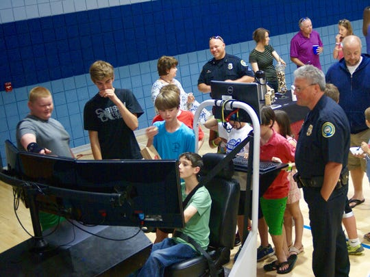 Children use the Gallatin Police Department's portable driving simulator during the ninth annual Taste of Gallatin held at the Gallatin Civic Center on Thursday, June 2.