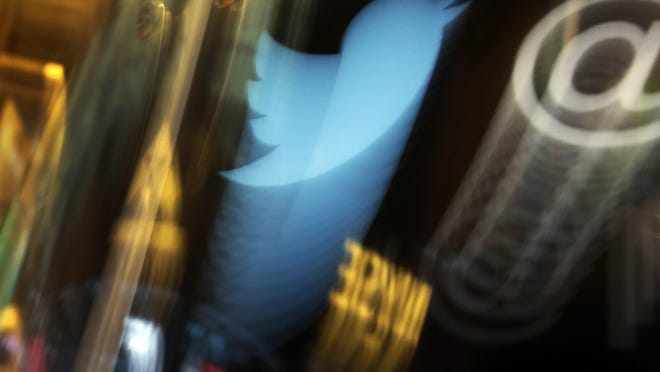 The Twitter logo appears on an updated phone post on the floor of the New York Stock Exchange. [Richard Drew/The Associated Press/File)