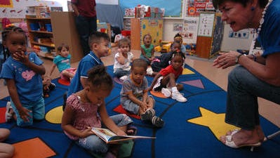 Volunteers read to students during United Way's Day of Literacy-Read United program, Oct. 1, 2009, at Head Start in Scott, Louisiana.