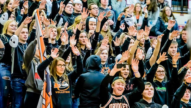 The Charlotte student section sends good vibes to a boy's basketball player as he shoots freethrows during the Orioles' game with Eaton Rapids Tuesday January 17, 2017 in Eaton Rapids.  KEVIN W. FOWLER PHOTO