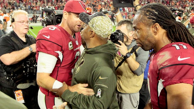 Former Cincinnati quarterback Carson Palmer and Cincinnati Bengals head coach Marvin Lewis shake hands after the NFL Week 11 game between the Arizona Cardinals and the Cincinnati Bengals at University of Phoenix Stadium in Glendale, Ariz., on Sunday, Nov. 22, 2015. The Bengals fell to 8-2 with the 34-31 loss to the Cardinals on a last second field goal.