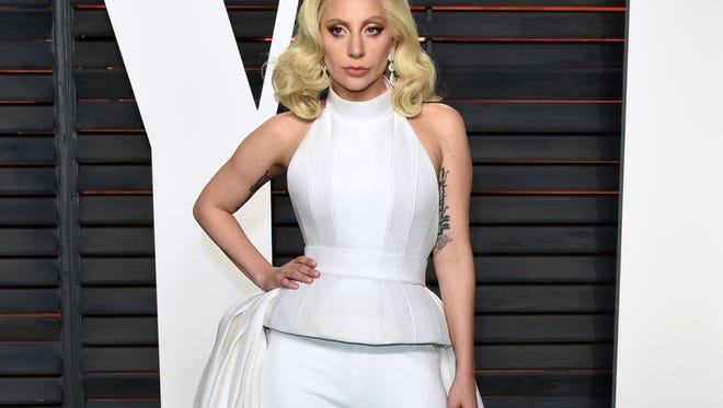 FILE - In this Feb. 28, 2016 file photo, Lady Gaga arrives at the Vanity Fair Oscar Party in Beverly Hills, Calif. One of the country's most impoverished cities will get some time in the Democratic convention spotlight Thursday, July 28, 2016, with some help from Lady Gaga. Thousands of convention delegates have been invited across the Delaware River to Camden for an afternoon concert with the pop star. (Photo by Evan Agostini/Invision/AP, File)