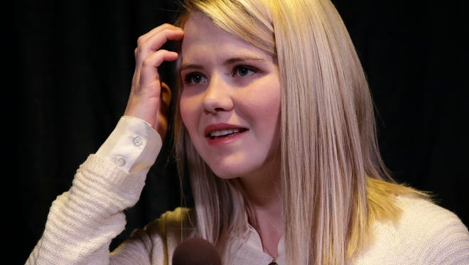 In this April 2015 photo, Elizabeth Smart looks on during a news conference  in Sandy, Utah.  Smart says pornography led to her captor raping her more than he already did in the nine months she was held.