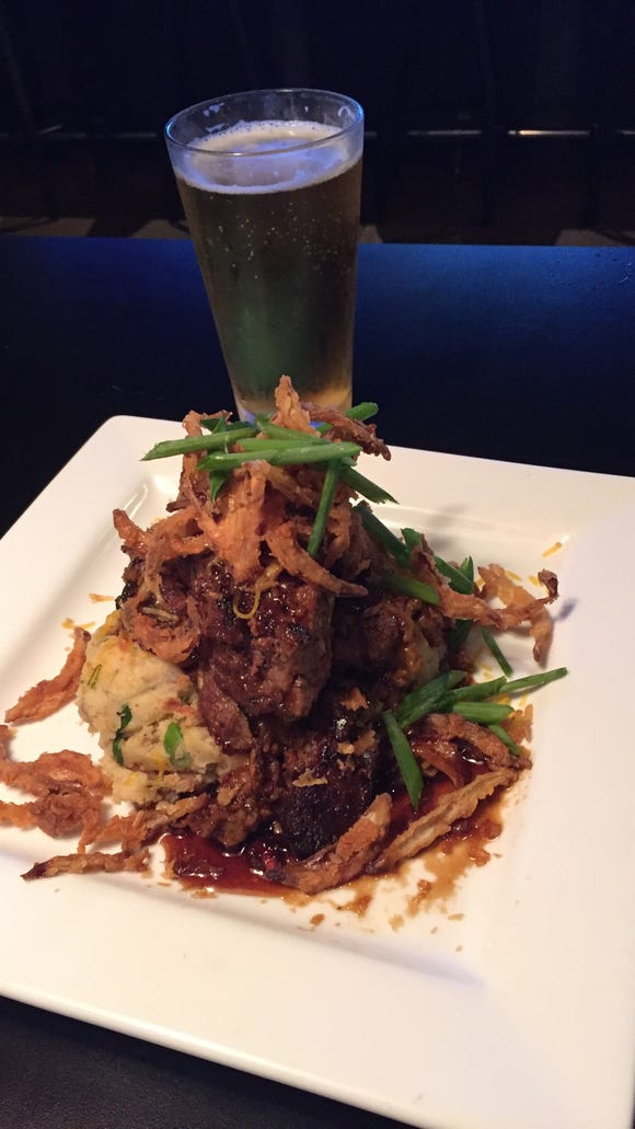 The Mount Arvon meatloaf with a pint of Rochester Mills Pine Knob Pilsner