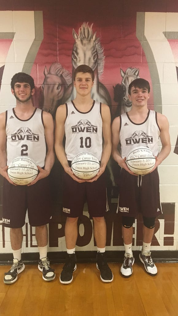 Three players for the Owen boys basketball team scored their 1,000th career point this season, from left to right, Brian Bartlett, Mathew Brown and Ben Craig.