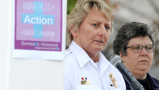Capt. Shari Robertson of the Mansfield Police Department speaks Wednesday during the Domestic Violence Awareness Month kick-off in downtown Mansfield.