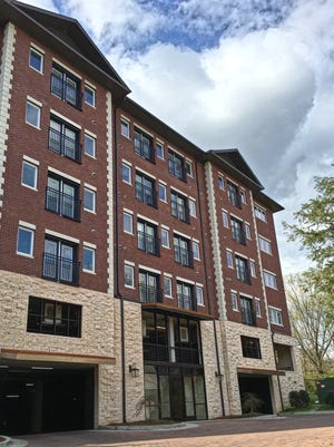 The 82-unit Village Green Hills Apartments is at 2215 Abbott Martin Road.