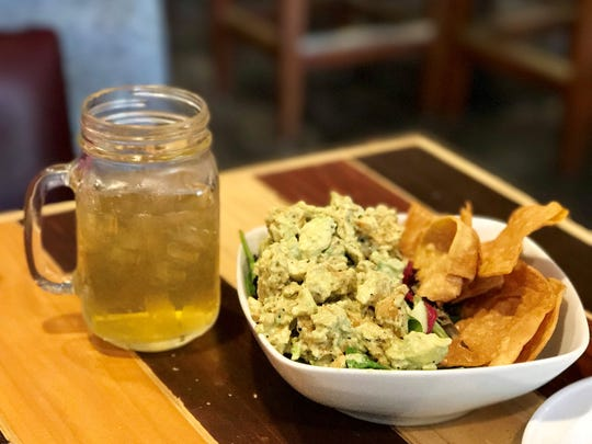 The chicken salpicon salad from Downtown's Delight is made with chunks of grilled chicken, guacamole, lettuce, celery hearts, red onion and totopos. The salad is shown with a glass of refreshing mango-infused green tea.