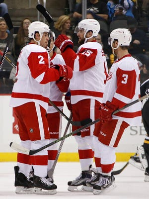 Detroit Red Wings Brendan Smith, Riley Sheahan and Nick Jensen celebrate a goal Oct. 5, 2016.