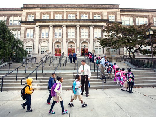 Students file up the stairs to Warner Elementary School.