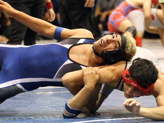 Derek Armendariz, top, of Bowie tangles with Zachariah Daly of Jefferson in the 160-pound class finals match Saturday during the Bowie Wrestling Tournament. Armendariz came out on top.