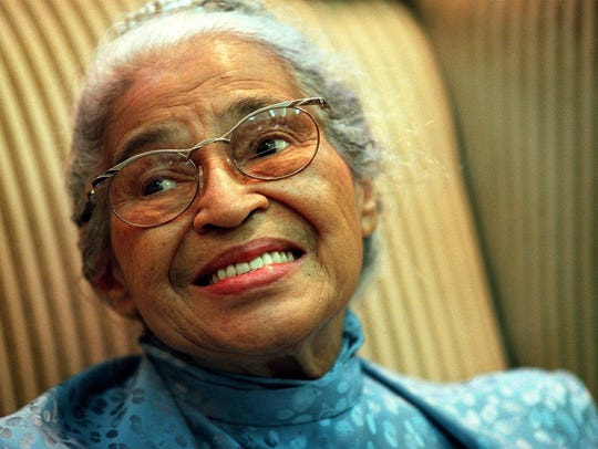 Civil Rights legend Rosa Parks smiles as she is honored