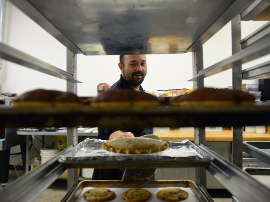 Baker Matt Kline puts a pie on a cooling rack at Whipped Monday, Nov. 21, 2016 in Lansing. The Lansing region has seen an influx of smaller, local bakeries recently.
