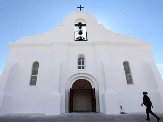 A chapel worker enters the San Eliceario Presidio Chapel in the village of San Elizario, just East of El Paso. There will be a celebration there Saturday.