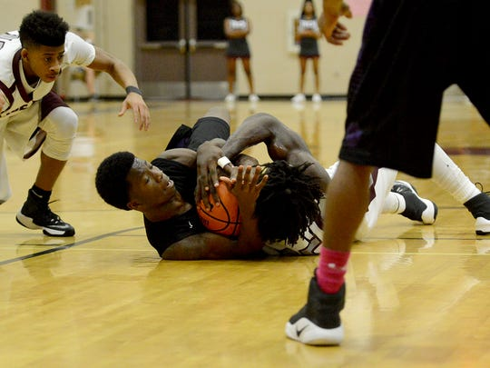 Haywood's Xavier Walker battles Liberty Tech's Elijah Harris for posession during their game, Monday evening.