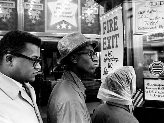 A small group of demonstrators tries to gain admittance to the Tennessee Theater in downtown Nashville on Feb. 21, 1961. Aiding the students is the Rev. James Lawson, left.