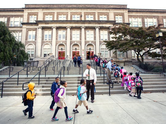 Students file up the stairs to Warner Elementary School in this file photo. One of Delaware's priority schools, it did not show significant gains on state test scores this year.