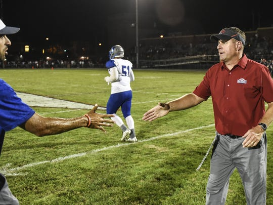 Cedar Crest head coach Rob Wildasin and Lebanon head coach Gerry Yonchiuk shake hands after Cedar Crest defeated Lebanon 26-14 during the annual Cedar Bowl on Friday, Sept. 2, 2016.