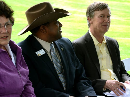 Colorado Gov. John Hickenlooper, right, is pictured