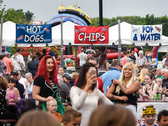 People gather in the entrance area Saturday, June 9, 2018 at the Libertyville block party as part of Sartell Summerfest celebrations.