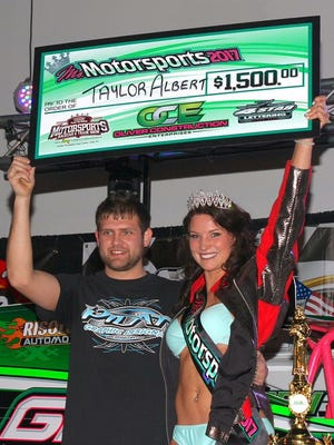 Northern Lebanon grad Taylor Albert, right, was crowned Ms. Motorsports 2017 during Day 2 of the  2017 Pioneer Pole Buildings Motorsports Race Car & Trade Show  at the Greater Philadelphia Expo Center over the weekend. A 2012 Northern Lebanon alum was a standout softball catcher for the Vikings during her high school days. Pictured with Albert is her boyfriend and race car driver Jared Umbenhauer. , Albert's accomplishments can be followed on her Facebook page -Ms. Motorsports 2017 – Taylor Albert.