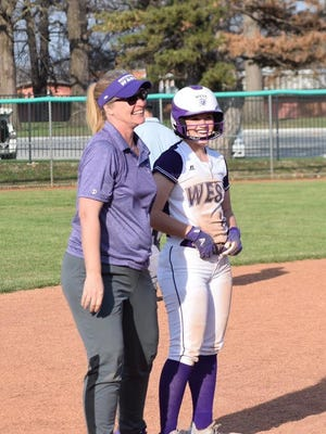 Lori Zook, left, has stepped down as Topeka West's softball coach after six years with the Chargers.