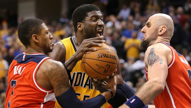 Indiana Pacers center Roy Hibbert fights for a rebound with Washington Wizards guard Bradley Beal, left, and center Marcin Gortat  in overtime. The Pacers beat the Washington Wizards 99-95 in double overtime at Bankers Life Fieldhouse on Tuesday, April 14, 2015.