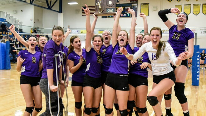 Lexington girls celebrate a volleyball win against Oattawa Glandorf Saturday at Ontario  to move on to the state final four.