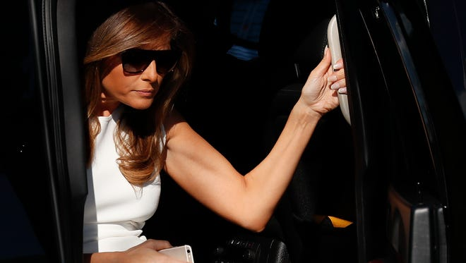 First lady Melania Trump steps from her motorcade vehicle as she arrives at the presidential viewing stand, Sunday, July 16, 2017, during the U.S. Women's Open Golf tournament at Trump National Golf Club in Bedminster, N.J.