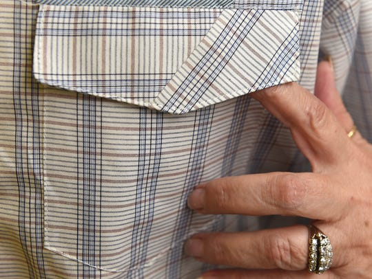 Janet Pray displays a men's shirt pocket pattern that