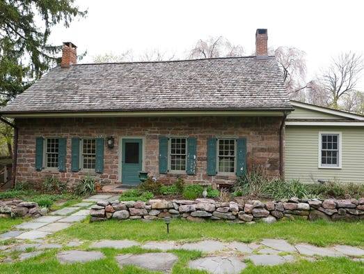 The exterior of the Blauvelt family home circa 1763, is photographed April 29, 2014 in Blauvelt. The house has original flooring, beams, fireplaces and doorways and was expanded by the owners in 2008.