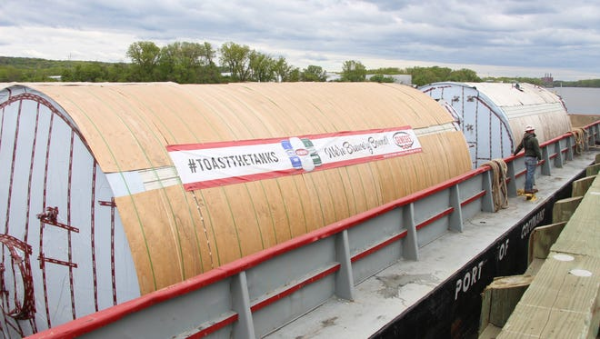 Genesee's new beer tanks, scheduled to be shipped via the Erie Canal, sit on barges on the Hudson River.