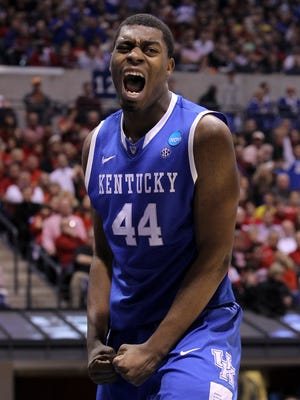 UK's Dakari Johnson, #44, celebrates a score against U of L during their game in the Sweet 16 at the Lucas Oil Stadium in Indianapolis. Mar. 28, 2014