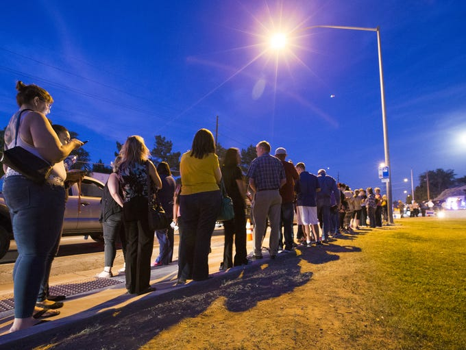 Voters wait in line to cast their ballots at Pilgrim