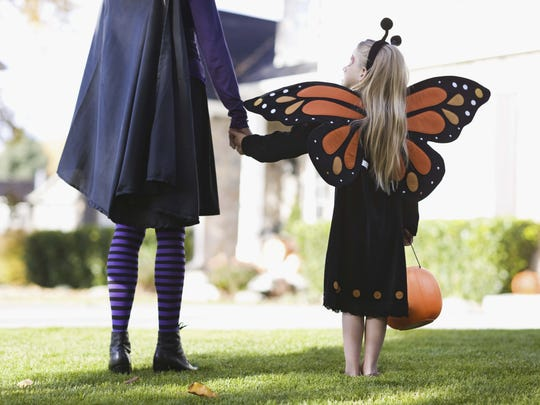 Girl and parent in Halloween costumes.