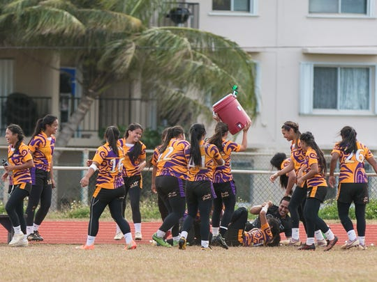 The George Washington Geckos celebrate winning the 2015 championship during the Independent Interscholastic Athletic Association of Guam/Guam Rugby Football Union High School Rugby League girls, varsity cup at George Washington High School.