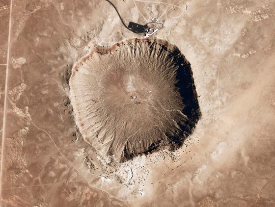 A meteorite impact crater in the northern Arizona desert.