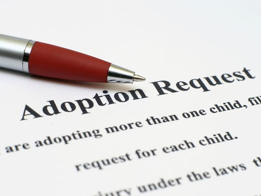 635969439706599522-AdoptionPapers.jpg