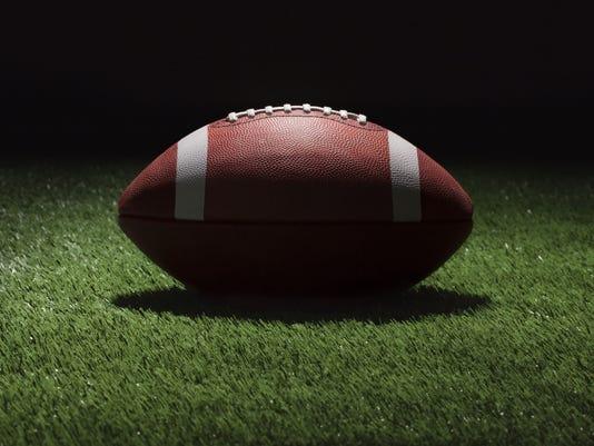 636072957944446016-SPORTS-football-on-grass.jpg