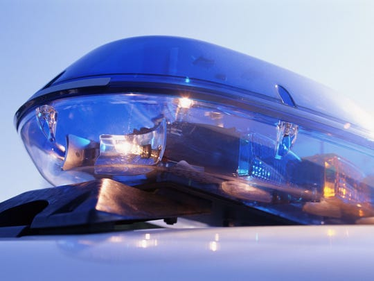 Close-up of emergency lights on police car.