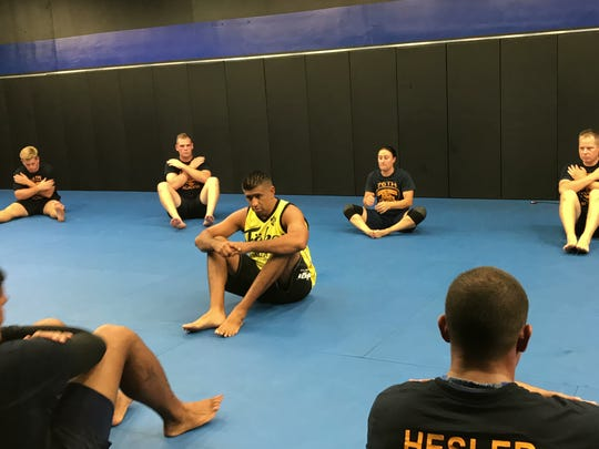 Jiu-Jitsu instructor Aurelio Gallegos Jr. talks to cadets of the 76th Corpus Christi Police Academy during a four-hour defensive tactics training session.