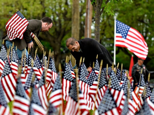 2,393 American flags are placed as the Afghanistan War Flag Memorial is reinstalled at Prospect Hill Cemetery in York City, Saturday, April 22, 2017. An additional 303 state flags were  placed commemorating fallen Pennsylvanians who lost their lives in  Afghanistan and Iraq. Dawn J. Sagert photo